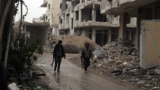 صورة العفو الدولية تتهم فصائل وهابية مدعومة دوليا بارتكاب جرائم حرب في سوريا