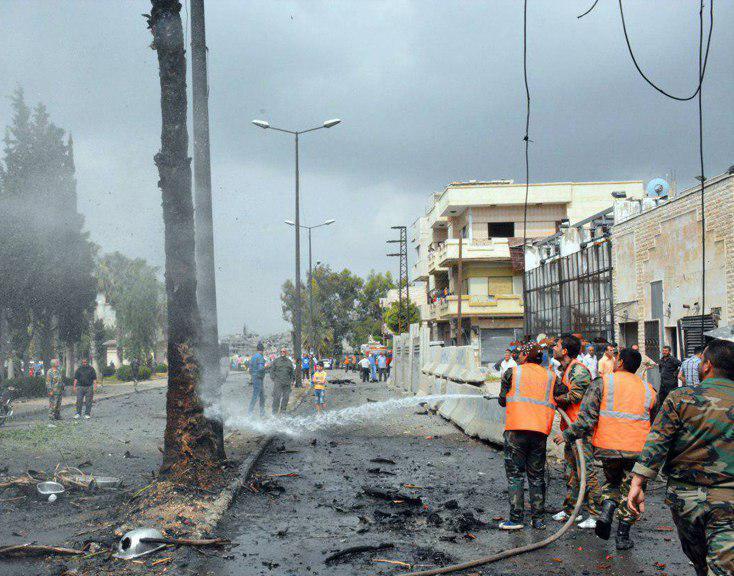 صورة داعش الارهابي يفجر سيارة مفخخة في مدينة حمص السورية ويقتل ويصيب 18 شخصا