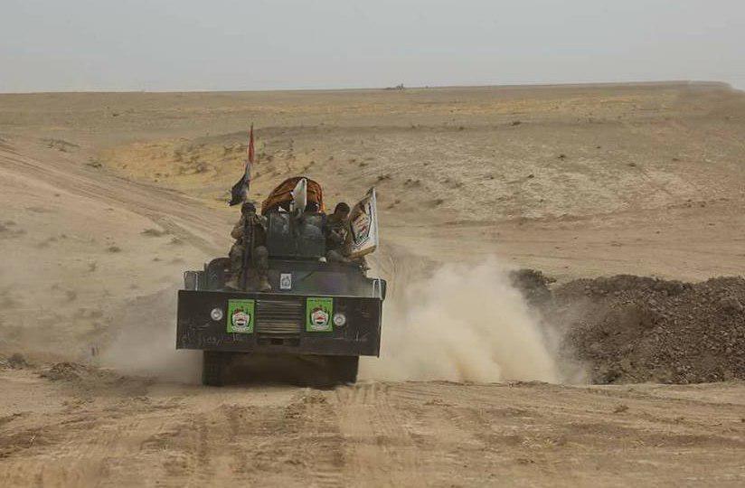 صورة الحشد الشعبي والجيش السوري يلتقيان عند الحدود السورية والعراقية