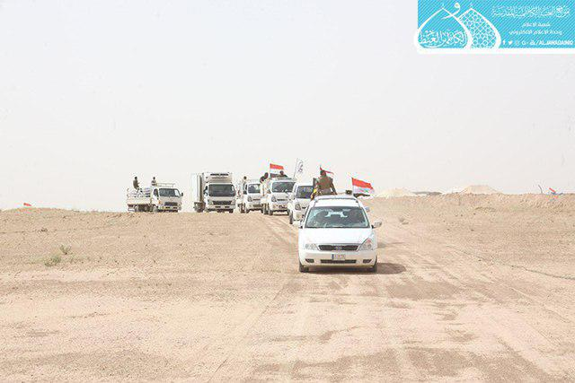 صورة العتبة الكاظمية المقدسة تتفقد قطعات الحشد الشعبي في سنجار ومشارف الحسكة قرب الحدود العراقية السورية