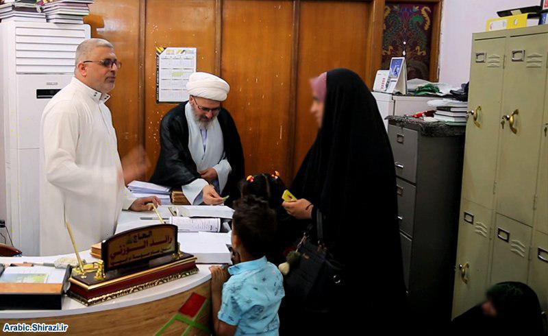 صورة مؤسسة أمّ أبيها توزّع السلات الرمضانية للمتعفّفين والأيتام في كربلاء المقدسة