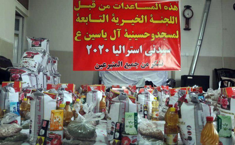 صورة توزيع سلال المواد الغذائية للمتعفّفين في أصفهان الإيرانية
