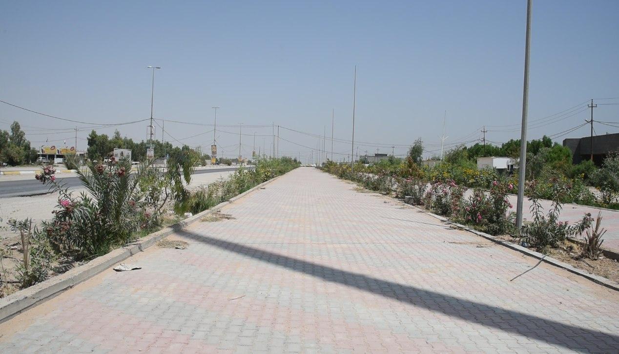 صورة اعادة تأهيل اكثر من 5 كيلومترات في طريق يا حسين الرابط بين كربلاء المقدسة والنجف الاشرف