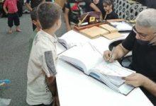صورة مؤسسة أمّ أبيها الإنسانية في كربلاء المقدسة توزّع مساعداتها الشهرية على الأيتام والمتعفّفين