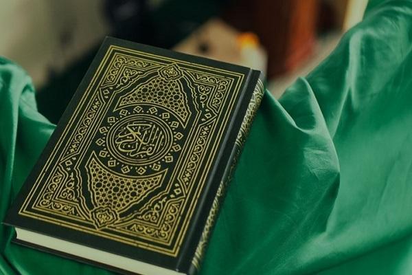 صورة خبیر اجتماعي کندي: الإساءة للقرآن الكريم في الغرب تهدف إلی طرد المسلمین