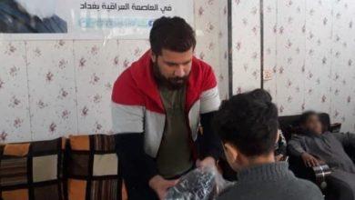 صورة توزيع الألبسة والكفالات المالية لعوائل الأيتام في بغداد