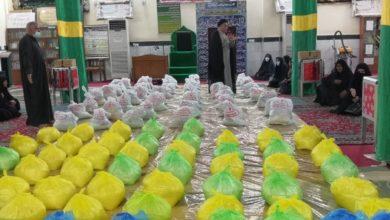 صورة توزيع المئات من السلال الغذائية للمحتاجين في النجف الاشرف