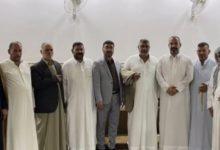 صورة تسليم راية عزاء جمهورية العراق المركزي للمعزين في النجف الأشرف