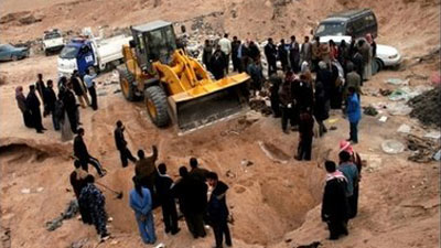 Photo of Mass grave of 23 truck drivers found in Iraq's recaptured Suleiman Bek