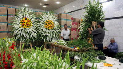 Photo of The Holy Shrine of Imam Ali decorated with more than 14,000 natural flowers on the occasion of Eid al-Ghadir