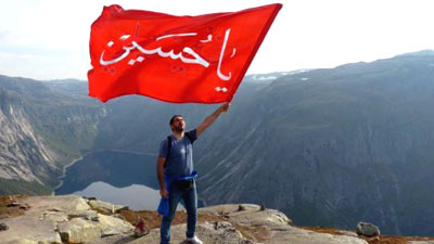 Banner of Imam Hussein raised on the rock of Trolltunga in Norway