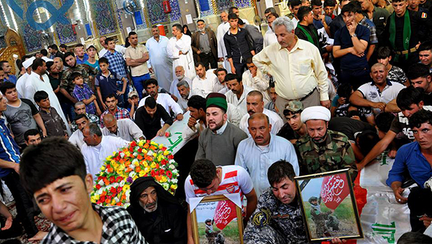 Photo of Shias from Tal Afar escorting their martyrs their final resting place inside the Imam Hussein Holy Shrine