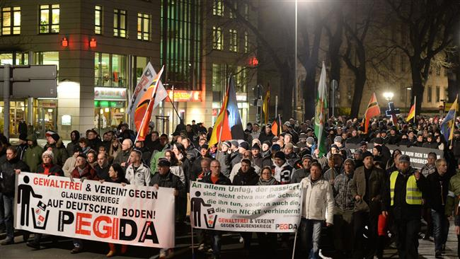 Photo of PEGIDA opponents and supporters stage demos in Germany