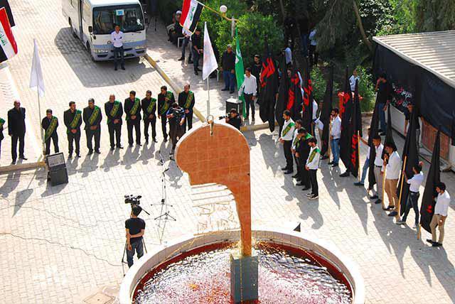 Photo of Ahlul-Bait University hoist Imam Hussein's flag Iraq