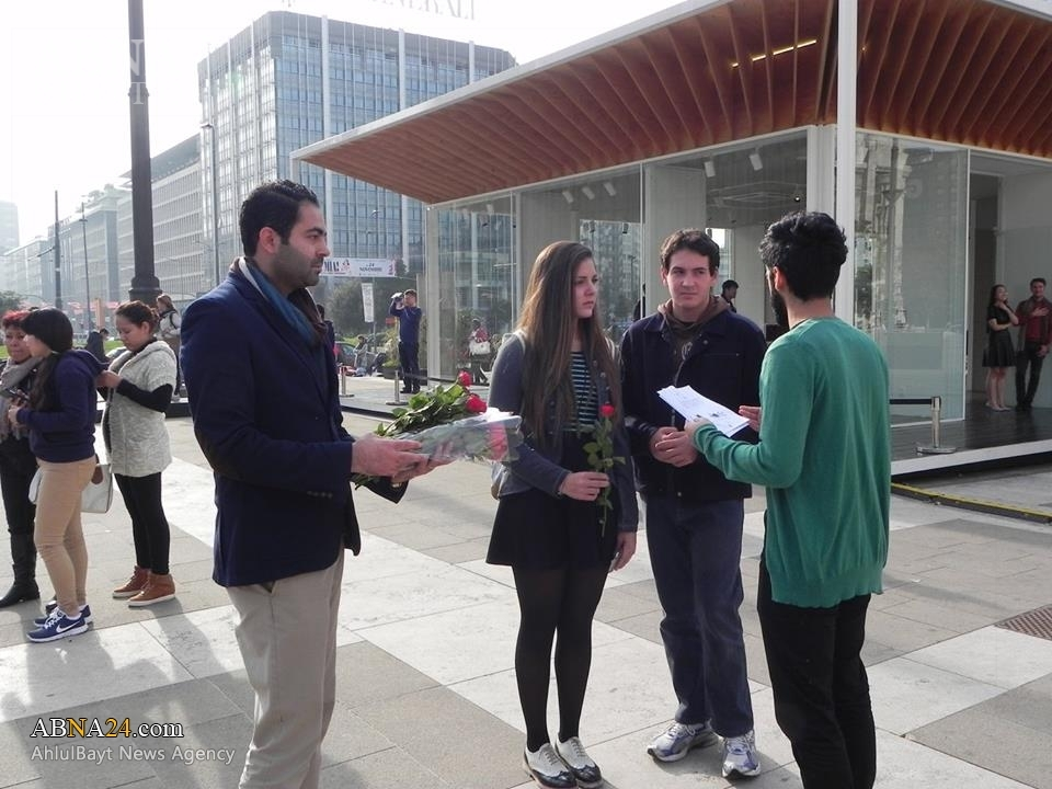 Photo of Organizers of WHO IS HUSSEIN campaign distribute leaflet and flower to promote Hussaini culture in Europe and America