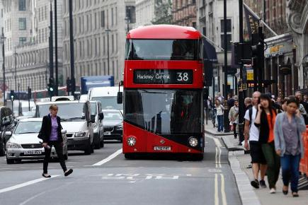 Photo of Muslim woman assaulted and kicked off London bus