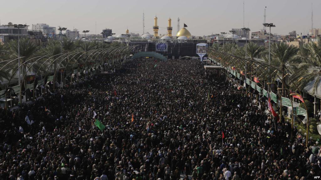 Photo of Millions of Shia pilgrims continue walking towards Karbala for Arbaeen