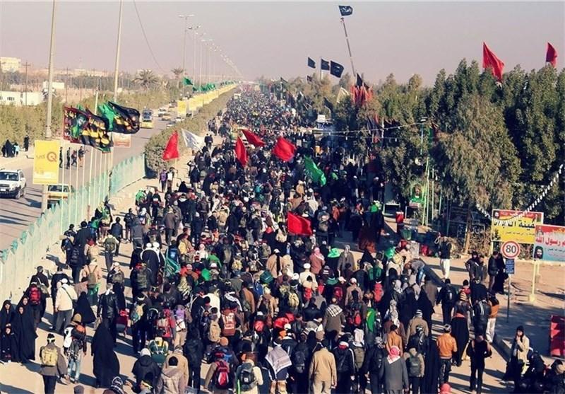 Photo of Bahrainis shout anti-regime slogans on their way to Karbala