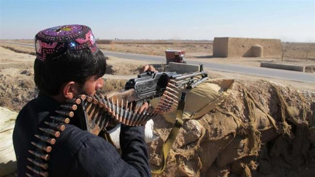 Photo of Afghan troops fighting Taliban for key district in Helmand