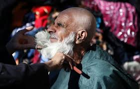 Photo of Police in Tajikistan shave beards of 13,000 Muslims