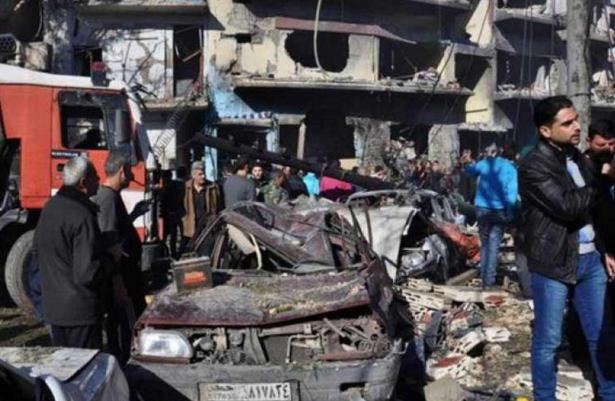 Photo of Twin Explosions  in the shia district of AL-Zahra in Homs, Syria Kills 26, Wounds 100