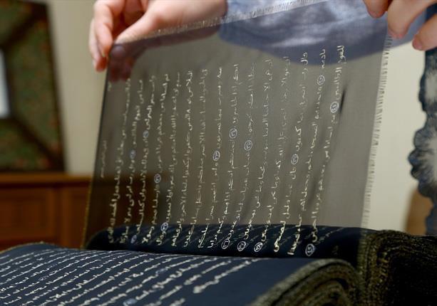 Photo of Azerbaijani painter writes Quran on transparent silk pages