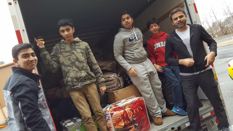 Photo of Washington DC 'Who is Hussain?' team donates garments to Parachinar people in Pakistan
