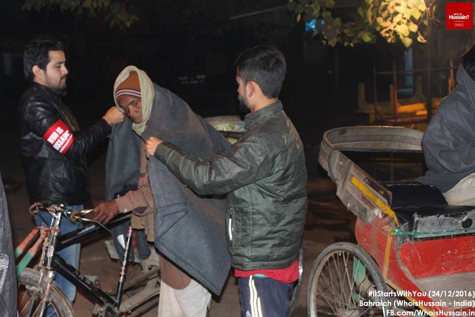 Photo of 'Who is Hussain?' volunteers distribute blankets to homeless in India