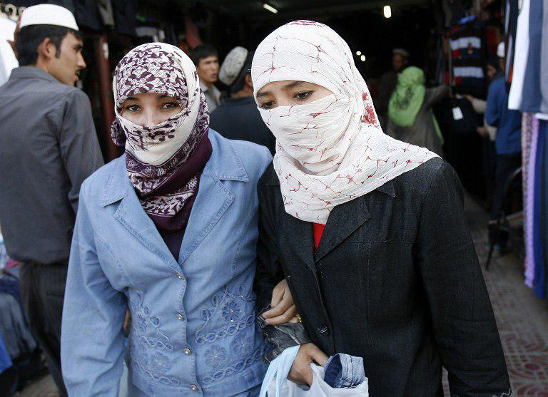 Photo of China bans long beards, full-face veils in western region of Xinjiang