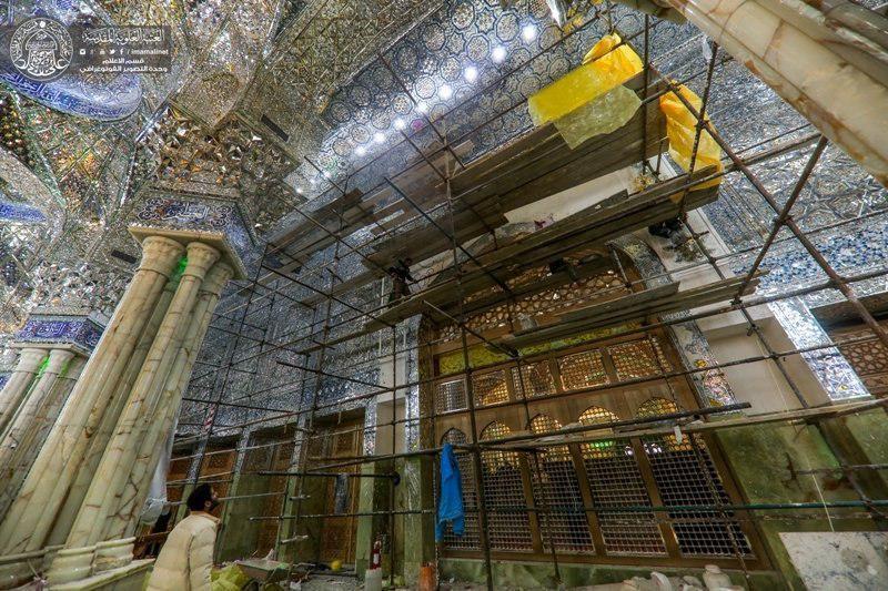 Photo of Staffs install wooden doors between Abu Talib colonnade and Lady Fatima Courtyard