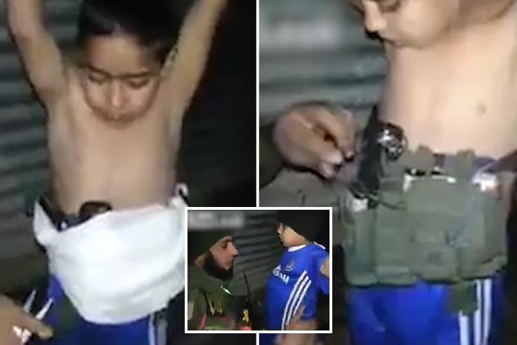 Photo of Iraqi soldier disarms 7-year-old boy after ISIS strap him with suicide belt