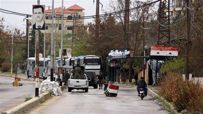 Photo of Buses enter militant-besieged Shia towns in Syria's Idlib to evacuate civilians