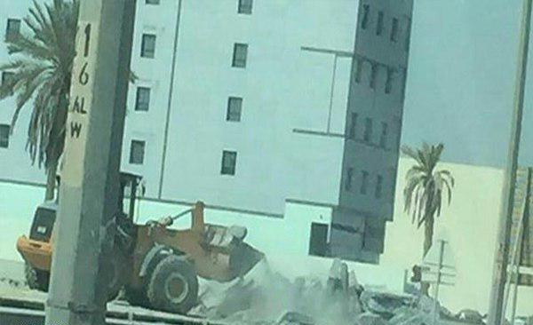 Photo of Manama's bulldozers plow through foundation for previously razed Shiite mosque