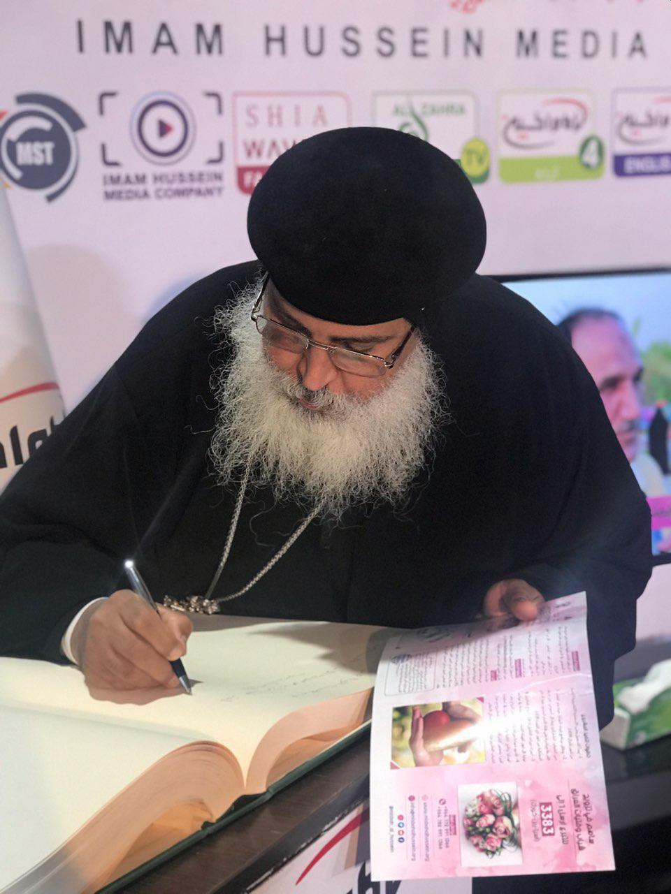 Photo of President of the Coptic community visits Imam Hussein Media Group's pavilion