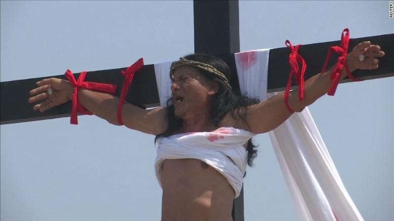 Photo of Every year a Filipino man marks Good Friday with an actual crucifixion