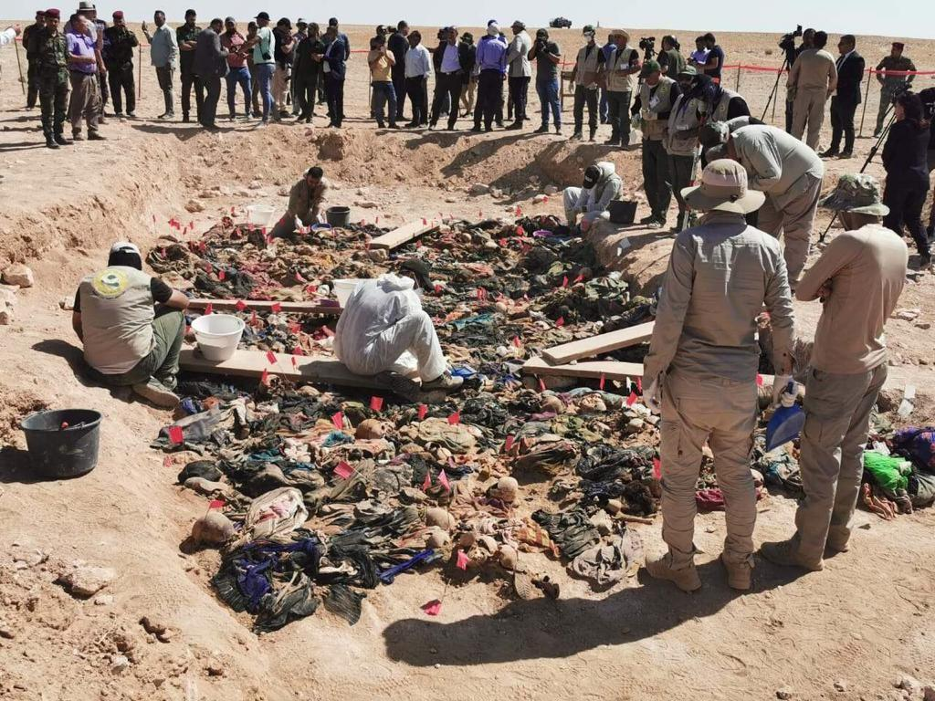 Photo of Mass grave for victims of Saddam's regime includes executed children in the Samawah desert