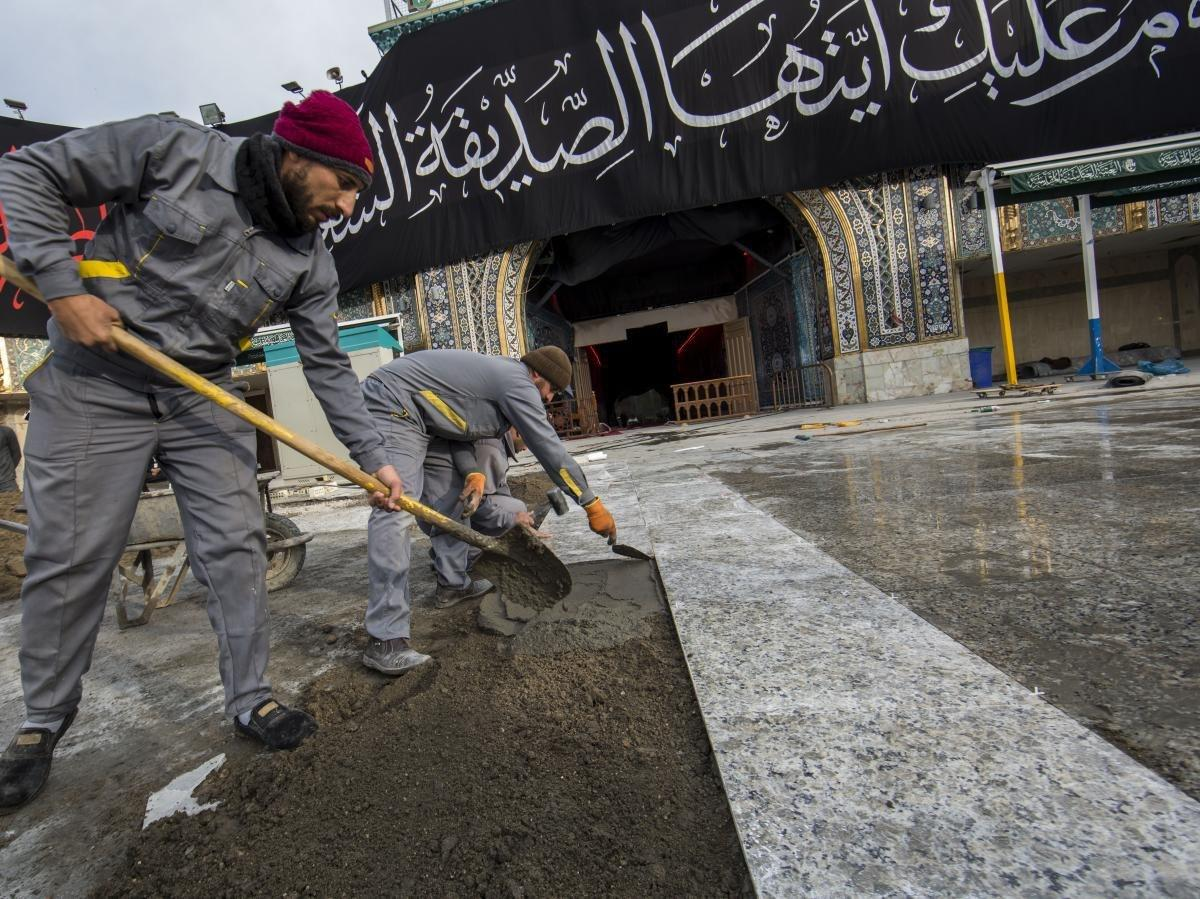 Photo of Covering the floor of the facade of the Qibla gate of the Holy Shrine of Aba al-Fadl al-Abbas