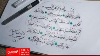 Photo of Young Egyptian man writes the Holy Quran in calligraphy