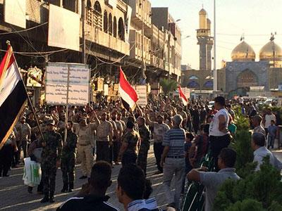 تصویر در لبیک به درخواست مرجعیت شیعه رژه نظامی در کاظمین برپا شد