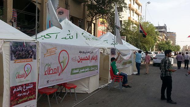 تصویر برپايى طرح جهانى اهداى خون در ولادت امام حسين عليه السلام و استقبال گسترده شيعيان