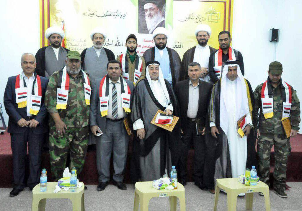 تصویر برگزاری مراسم تجلیل از رزمندگان حشد الشعبی توسط مؤسسه اهل بیت علیهم السلام در شهر بصره