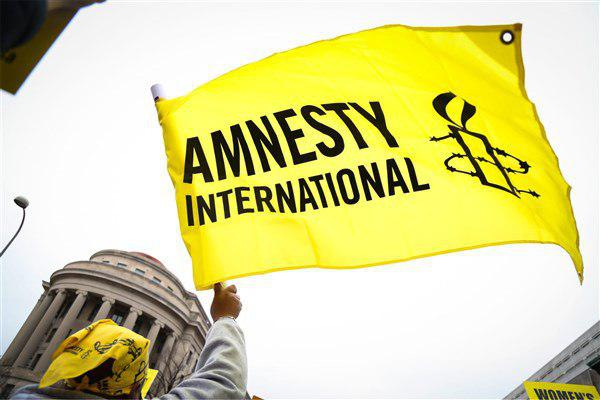 تصویر واکنش عفو بین الملل به فرمان منع ورود مسلمانان به آمریکا