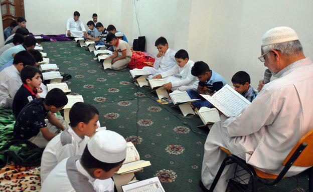 تصویر برگزاری چهاردهمین دوره آموزش قرآن توسط هیئت قرآن الحکیم در شهر مقدس کربلا