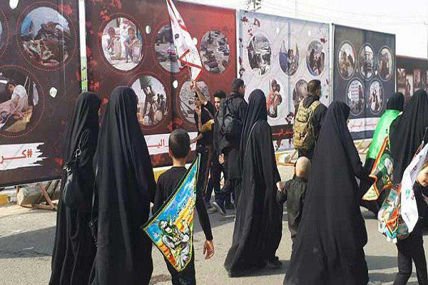 تصویر نمایشگاه «جنایات آلسعود» در پیاده روی اربعین