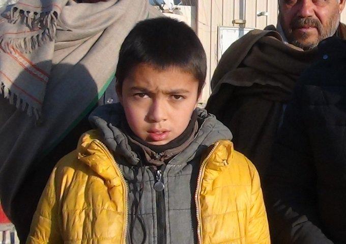 تصویر نجات کودک ربوده شده برای انجام حمله انتحاری در افغانستان