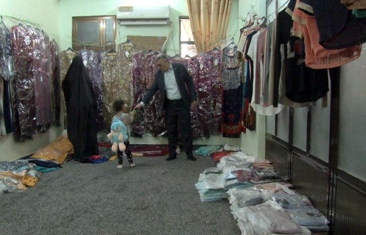 تصویر توزیع کمک های خیریه مؤسسه ام ابیها سلام الله علیها در میان خانواده های نیازمند شهر مقدس کربلا