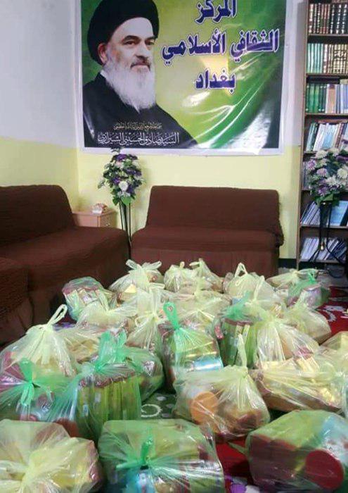 تصویر توزیع مواد غذایی در میان خانواده های نیازمند از سوی مرکز فرهنگی ـ اسلامی بغداد