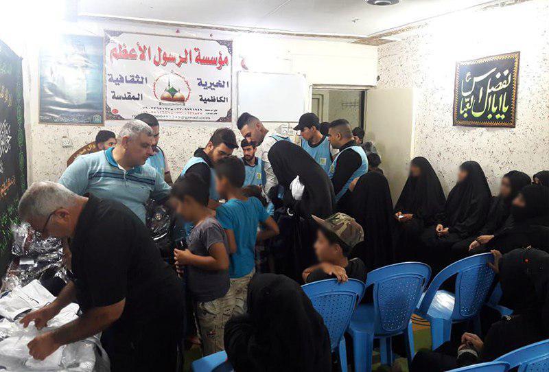 تصویر توزیع کمک های خیریه در شهر مقدس کاظمین