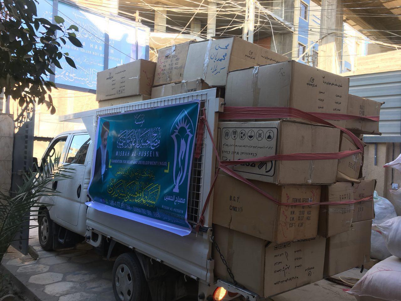تصویر توزیع کمک های زمستانه موسسه مصباح الحسین علیه السلام در استانهای مختلف عراق