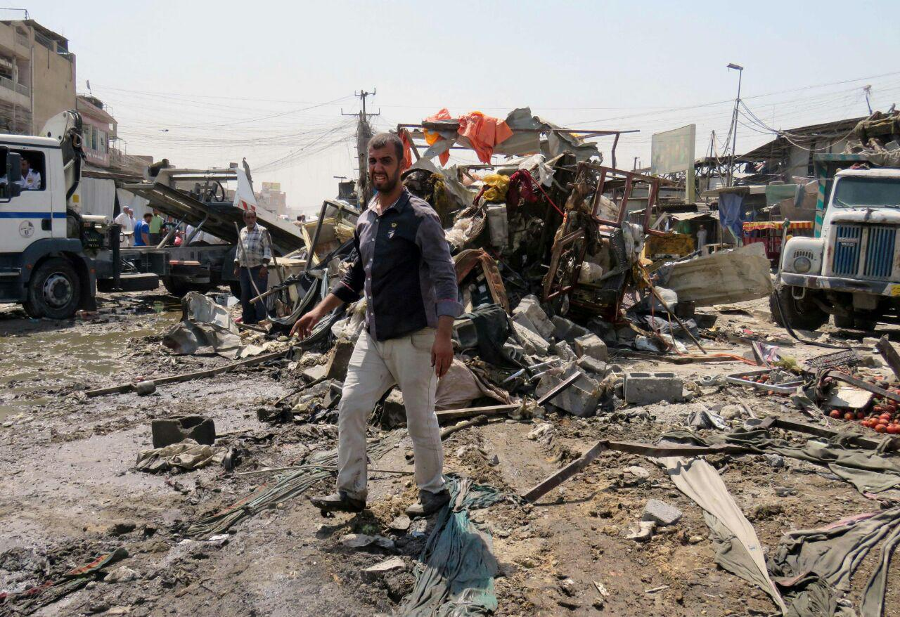 تصویر قربانی شدن دو کودک عراقی براثر انفجار بمب